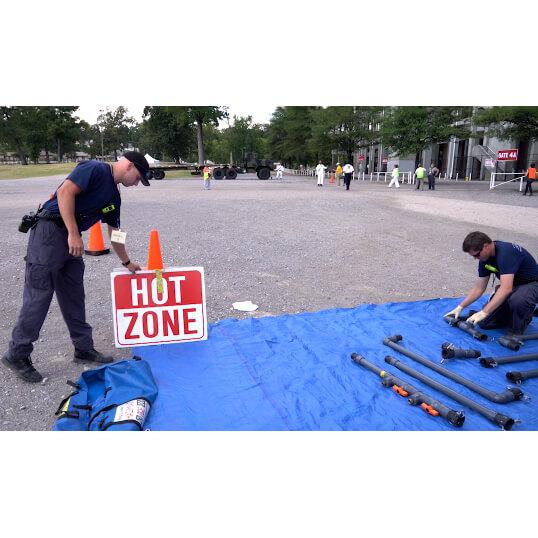 HazMat Responders Setting up DQE Decon Shower